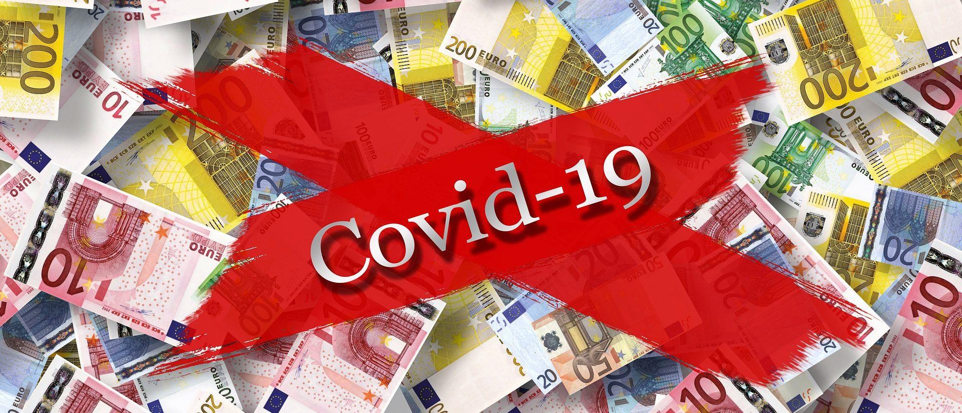 Geldscheine sind mit einem Kreuz durchgestrichen, auf dem Covid-19 steht